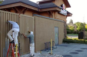 Timmins painting employees painting Applebee's