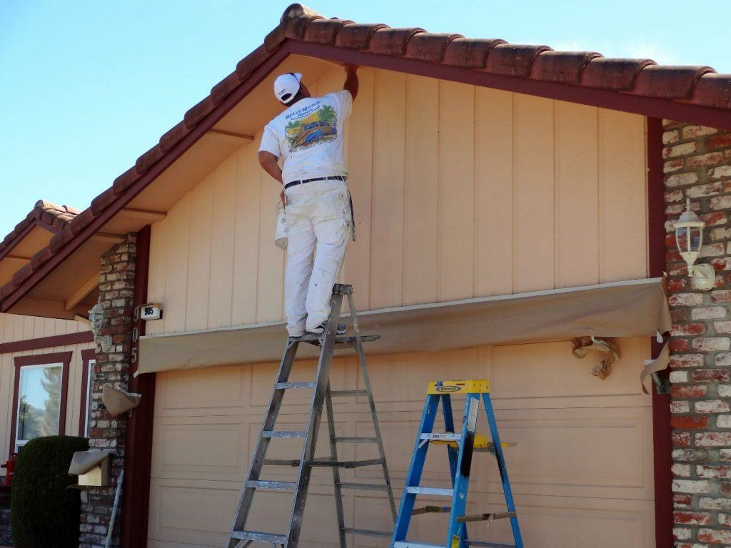 House Painter painting exterior of home