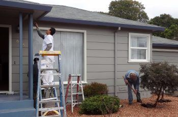 Timmins Painting working on exterior of home