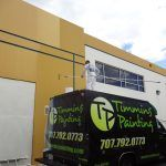 Timmins Painting employee on truck to paint building