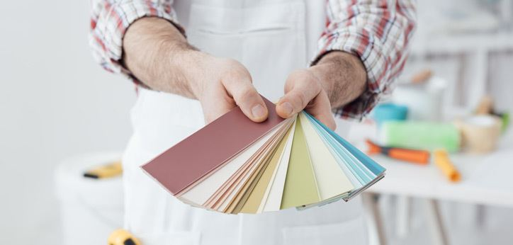 Painter fanning out color samples