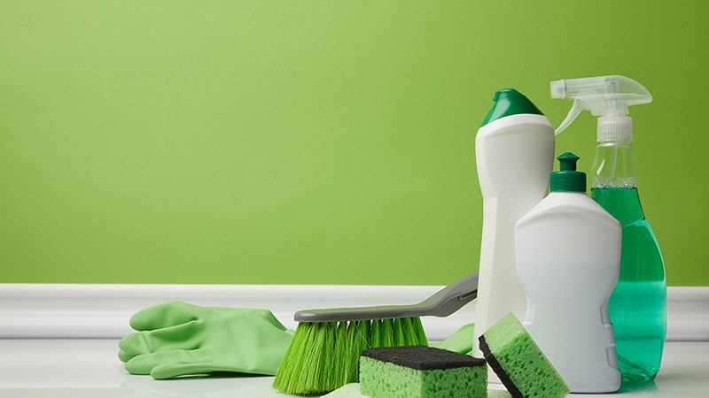 cleaning supplies and bright green painted wall