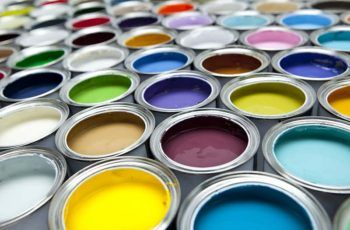 colorful selection of different paint colors in cans
