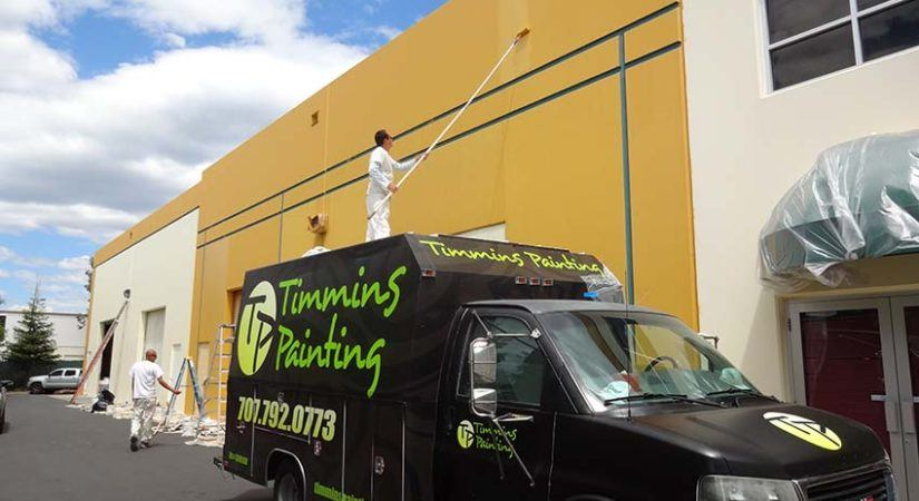timmins painting work truck and professional painter painting the exterior of a commercial building in sonoma county