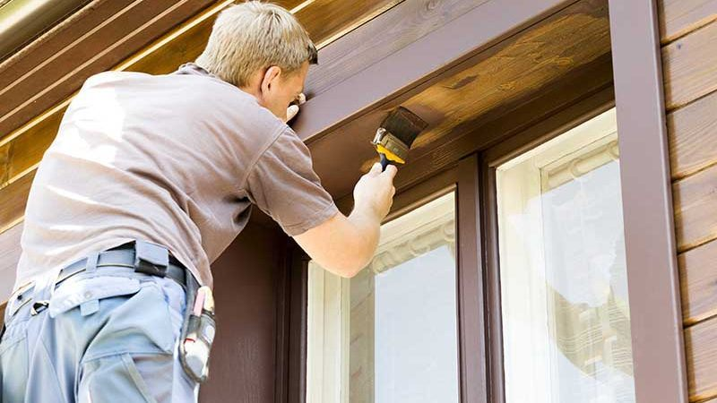 professional painting painting the exterior of a home