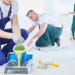 professional painters setting up a worksite to paint