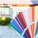 paint color swatches compared to exterior of home